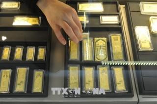 Giá vàng thế giới đi lên trước đồn đoán Fed nới lỏng tiền tệ