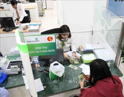Nhiều ngân hàng giảm phí dịch vụ về 0 đồng từ hôm nay 14-2