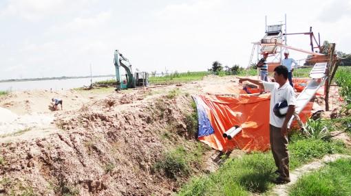 Trả lời về yêu cầu sử dụng đất bờ sông làm bến bãi chứa cát